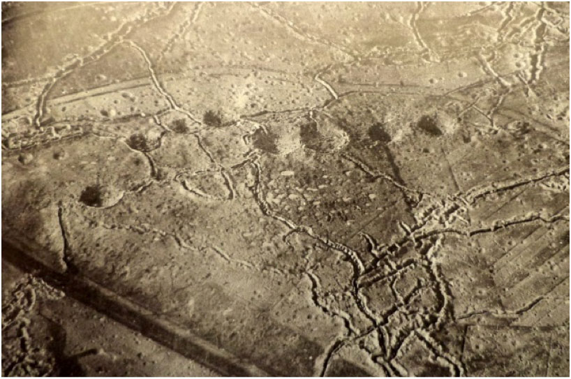 Hill 60 aerial view from the German side showing the mine craters, probably 1915. The feature in the bottom left of picture across the railway line is part of the feature called the Caterpillar (Imperial War Museum)