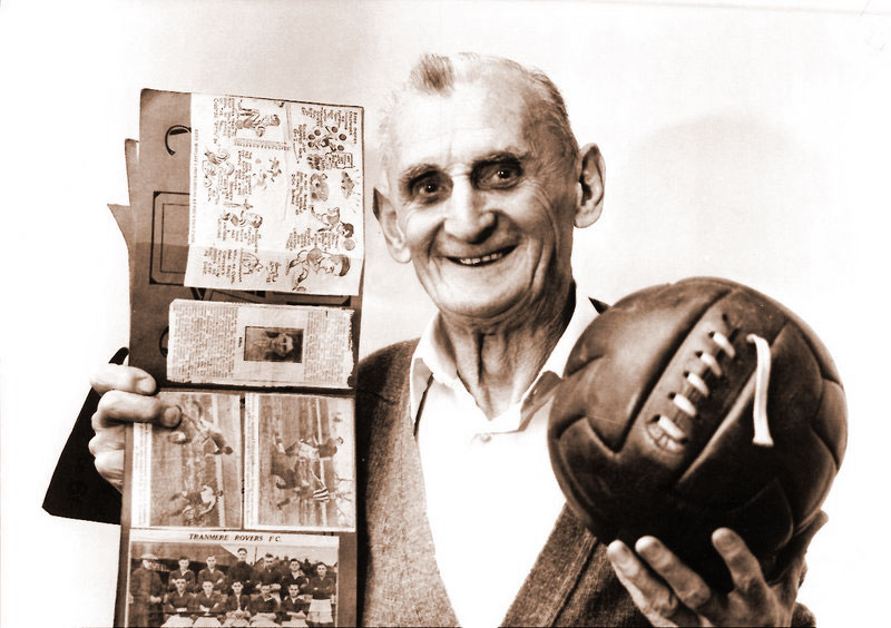 Bob Bell with ball and scrapbook